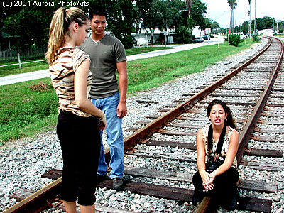 Three of my models taking a break during a shoot back on September 9, 2001. The model sitting down with the camera has my original 35MM film SLR, which I turned pro on a year before. I took this with one of my first digital cameras. This was a fun day!